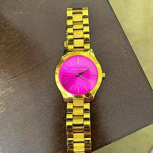 Gold, Micheal Kors watch with a hot pink face!